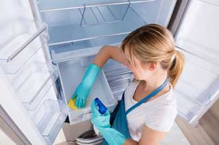 girl cleaning refrigerator
