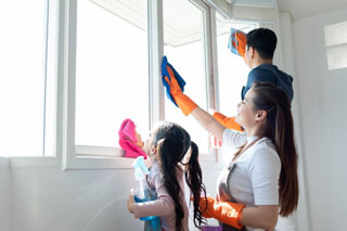 cleaning window with family