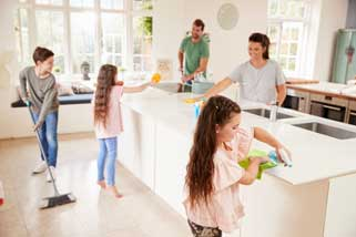 Cleaning kitchen with family