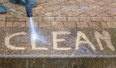 Cleaning brick patio with pressure washer